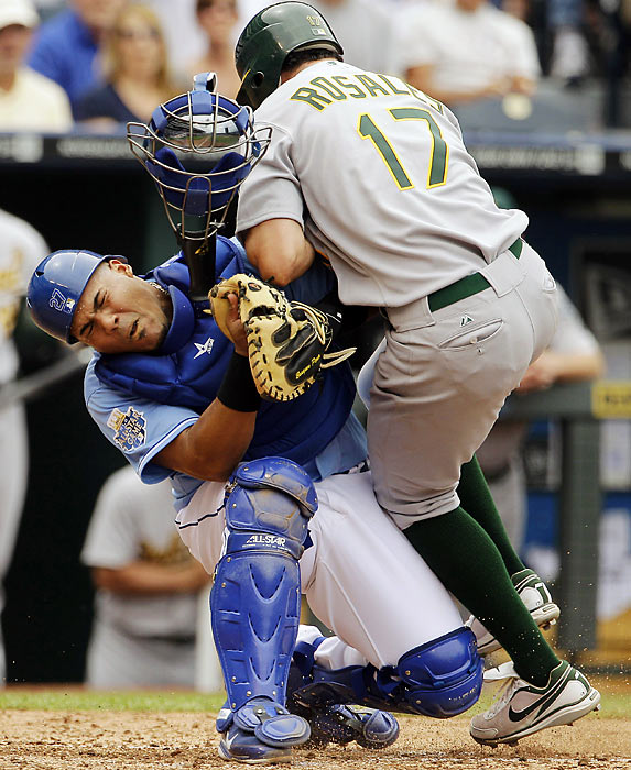 Oakland's Adam Rosales runs into Kansas City's Brayan Pena and is forced out.