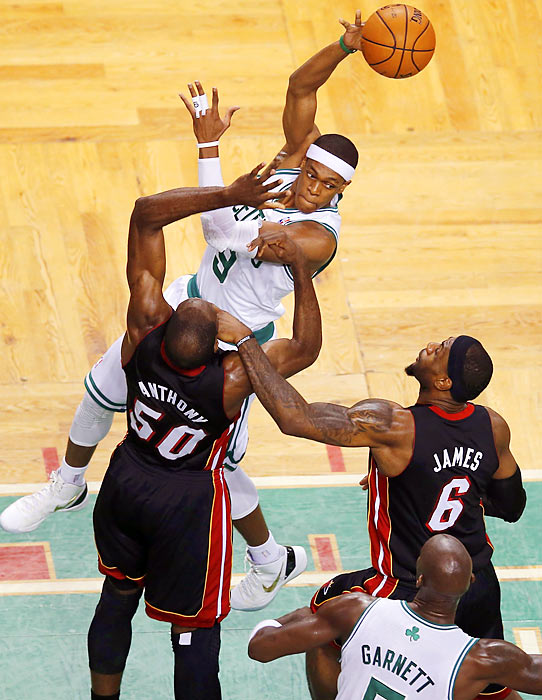 Boston guard Rajon Rondo dishes as Miami's Joel Anthony and LeBron James defend during Game 4 of the Eastern Conference Finals.