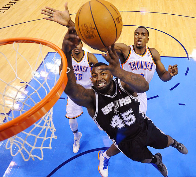 San Antonio Spurs forward DeJuan Blair gets to the basket past Oklahoma City Thunder power forward Serge Ibaka during Game 4 of the NBA Western Conference Finals.