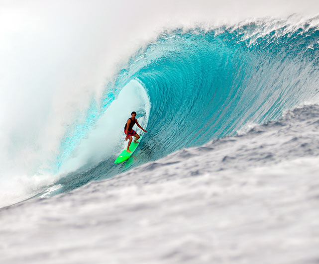 Diego Silva of Brazil rides the Cloudbreak barrel, a well-known wave in Tavarua, Fiji, during the free surf session at the Volcom Fiji Pro.