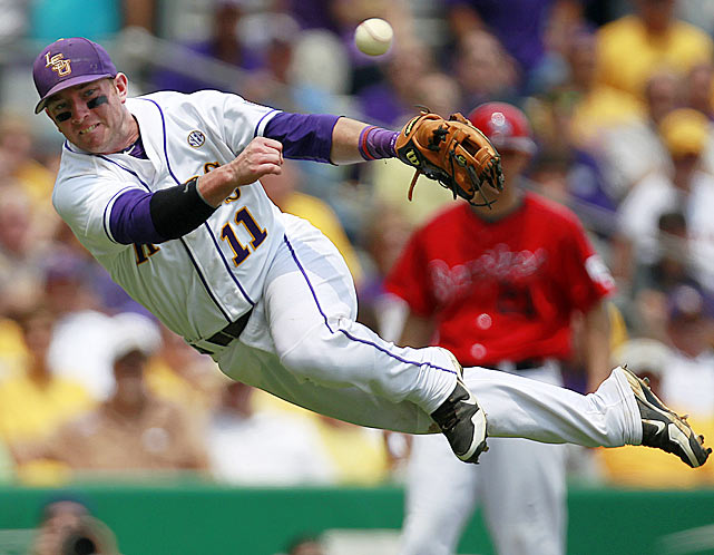 LSU third baseman Tyler Hanover dives in vain trying to throw out Stony Brook's Maxx Tissenbaum at first base during an NCAA super regional game on June 8. The game was postponed due to rain, but on Sunday, the Seawolves stunned the Tigers with a 7-2 victory to advance to the College World Series.