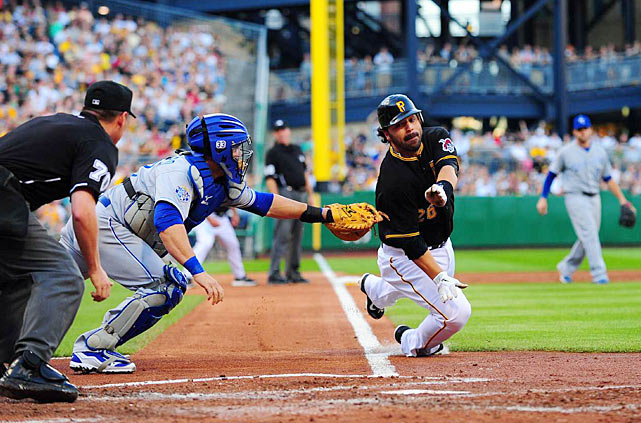 Pirates catcher Rob Barajas gets tagged out by Brayan Pena of Kansas City.  The Royals lost 3-2 at PNC Park.