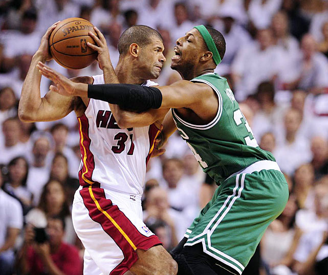 Paul Pierce aggressively swipes at the ball as Shane Battier and the Miami Heat battle back from behind to defeat the Celtics in Game 7 of the Eastern Conference Finals.