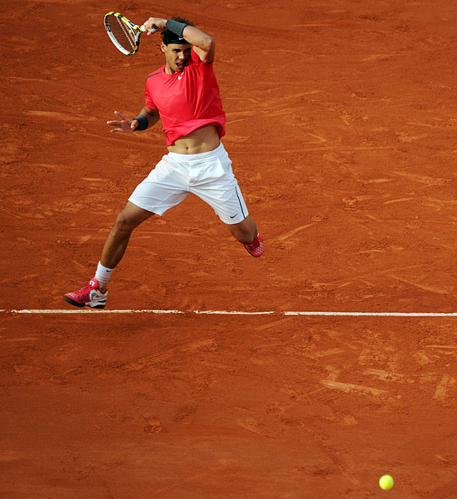 Rafael Nadal hits one of his signature powerful forehands against Juan Monaco at the French Open.  Nadal only dropped two games in an easy straight set victory.