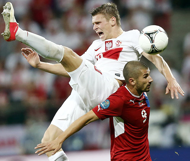 Poland's Artur Sobiech is up-ended by the Czech Republic's Jan Rezek during their Group A match in Wroclaw, Poland.
