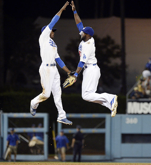 High-flying Dodgers Dee Gordon (left) and Tony Gwynn celebrate in a 7-6 win over the White Sox on Friday.