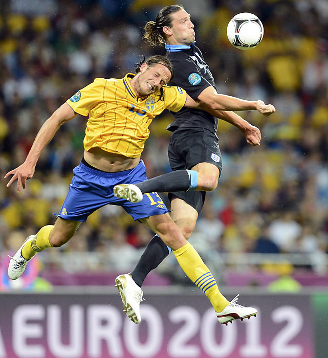 England striker Andy Carroll takes a ball down from his chest during a Group D matchup with Sweden.  Carroll scored England's first goal in a 3-2 comeback win.