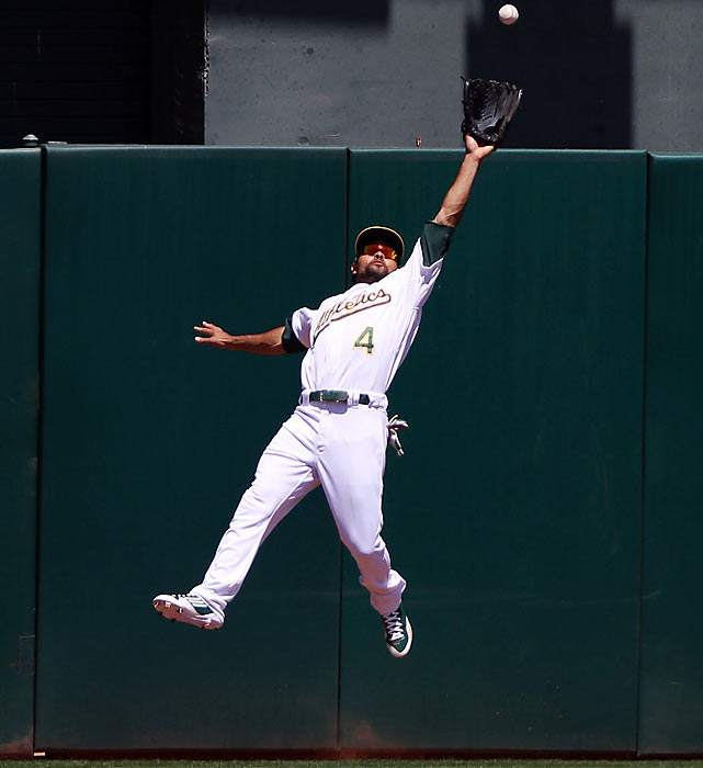 Oakland Athletics centerfielder Coco Crisp makes an outstanding leaping catch at the wall, robbing Padre Cameron Maybin of a potential home run.