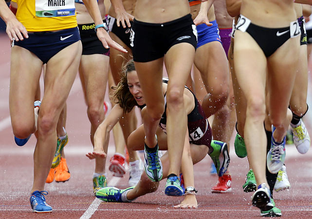 Natosha Rogers falls among a sea of legs during the women's 10,000-meter race on Friday in Eugene, Ore.