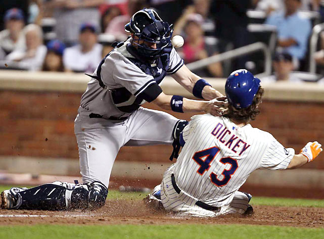R.A. Dickey slides safely into home during the Subway Series matchup against C.C Sabathia and the Yankees.  The Mets would eventually lose 6-5.