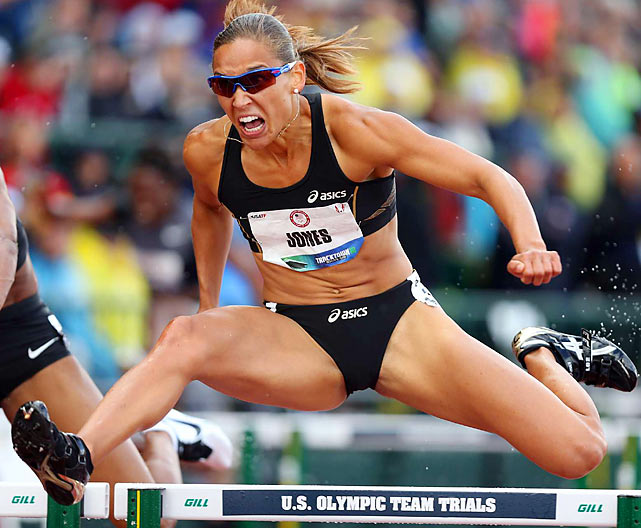 Lolo Jones clears a hurdle during the 100-meter semifinal.  Jones came in third with a time of 12.86 and later qualified for this summer's Olympics.