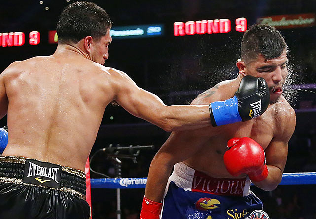 Josesito Lopez lands a right hook on Victor Ortiz during the ninth round of their WBC welterweight match in Los Angeles. Lopez scored the upset of the year to date when he broke Ortiz's jaw en route to a technical knockout victory.