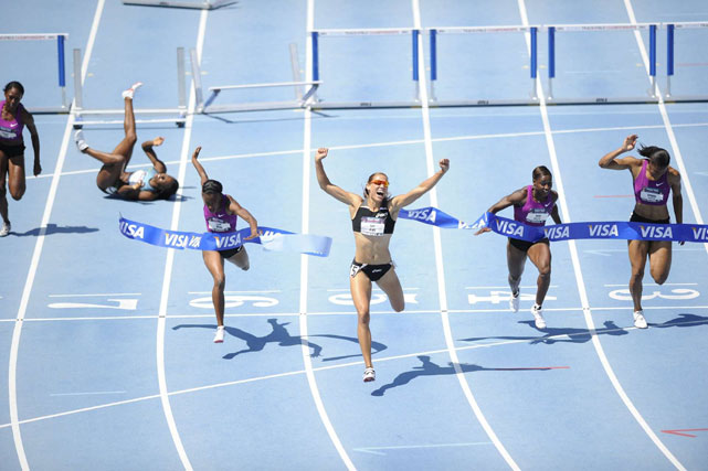 Jones celebrates her first-place win in the 100m during the 2010 USA Track & Field Championships.