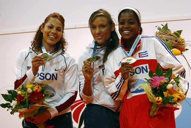 Gold medalist Jones poses with Candice Davisi of the U.S. (left) and Cuba's Anay Tejeda during the awards ceremony for the 60m hurdles at the IAAF World Indoor Championships in 2009.