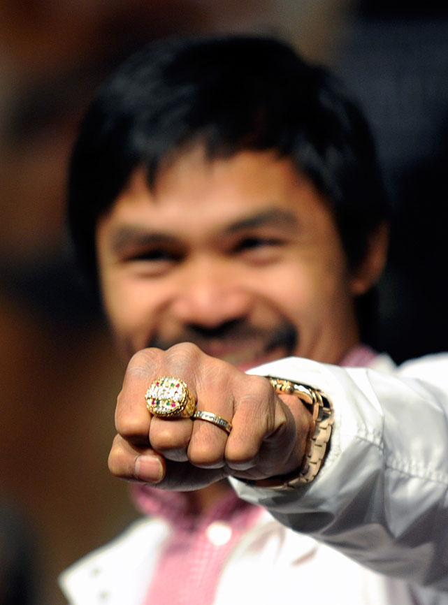 "Pacquiao displays a new ring during the new conference, one given to him by WBO president Francisco ""Paco"" Valcarcel."