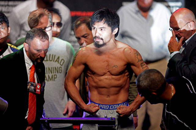 Pacquiao, who is making his fourth defense of the WBO welterweight title, weighed a career-high 147 pounds.