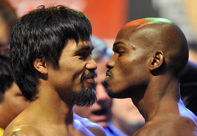 Pacquiao couldn't help but smile during the traditional staredown, while Bradley never broke from a menacing glower.