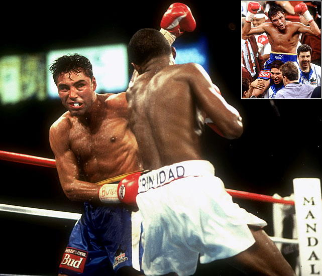 De La Hoya dominated the early rounds when he met Trinidad in a WBC/IBF welterweight unification fight between two undefeated fighters. Sitting on what he (and many) thought was an insurmountable lead, De La Hoya was content to simply rely on defense for the last three rounds.  De La Hoya even thought he was victorious (inset) before the decision was announced.  The decision sparked a major controversy and calls for a rematch, which never happened.