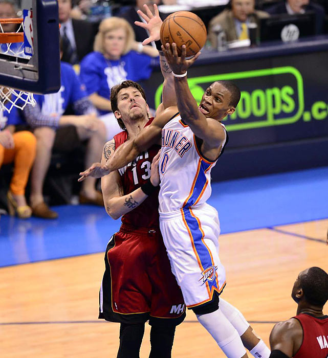 Russell Westbrook beats the defense of Mike Miller on a night in which the Thunder guard 27 points on 10-of-24 shooting from the field.