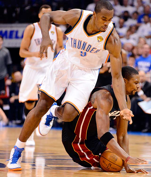 Serge Ibaka (left) and Chris Bosh battle for a loose ball in a game in which the Thunder trailed 18-2 at one point but closed to within 98-96 with 37 seconds remaining.