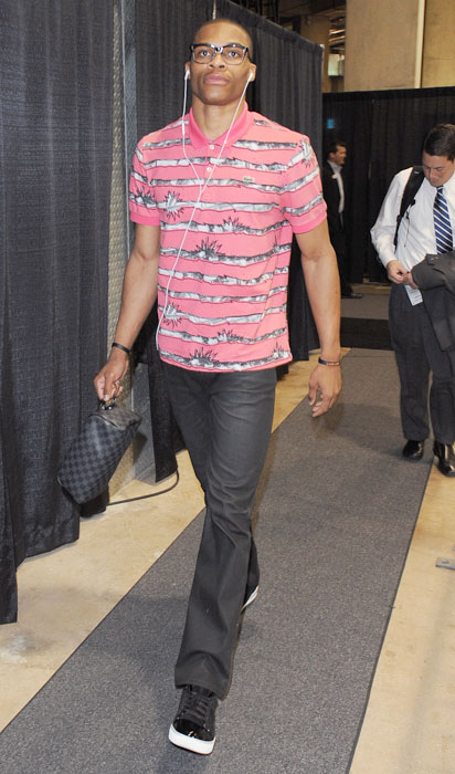 Sporting a pink Lacoste polo and glasses, the 23-year-old Russell Westbrook exits the arena following a game against the San Antonio Spurs. The Long Beach, Calif., native has become known as much for his eclectic fashion sense as he is for his aggressive and effective play at the point for his Oklahoma City Thunder.