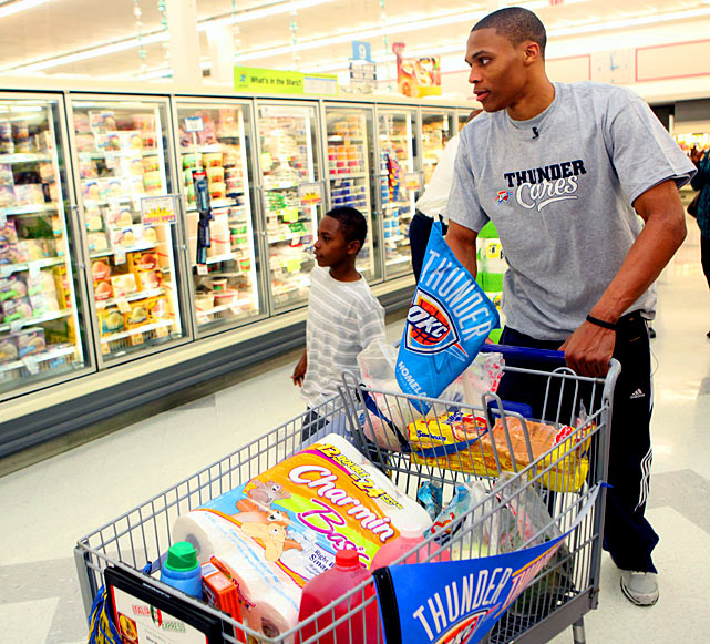 Westbrook helps an Oklahoma City family shop for groceries at a Homeland Store in March 2011. The family was chosen by the Memorial Park Boys and Girls Club to receive a grocery shopping spree, and the Thunder's starting point guard was credited with the assist.