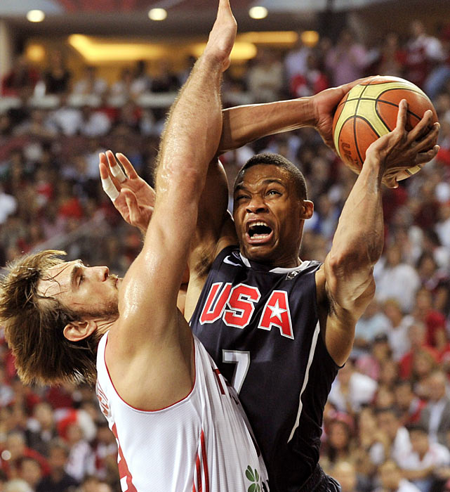 As a member of the United States team, Westbrook (7) battles to get a shot off against Turkey's Semih Erden in the final match of the 2010 FIBA World Championship held in Istanbul. Playing 24 minutes, Westbrook tallied 13 points in helping lead the U.S. to the title.