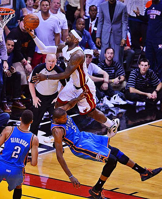 Kevin Durant tried to draw a charging foul on LeBron James on this play but got hit with his fifth foul.