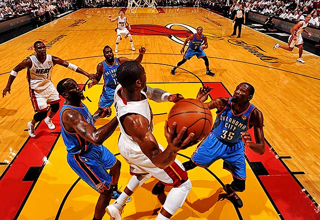 Dwyane Wade looks for an outlet with Kendrick Perkins, James Harden and Kevin Durant surrounding him.