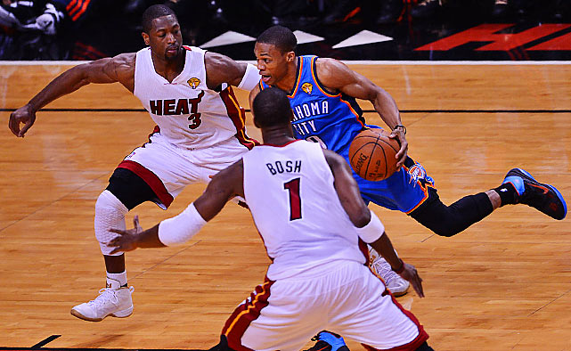 Russell Westbrook splits the Miami defense on his way to the basket. He had a terrific scoring night, finishing with 43 points on 20-of-32 shooting.