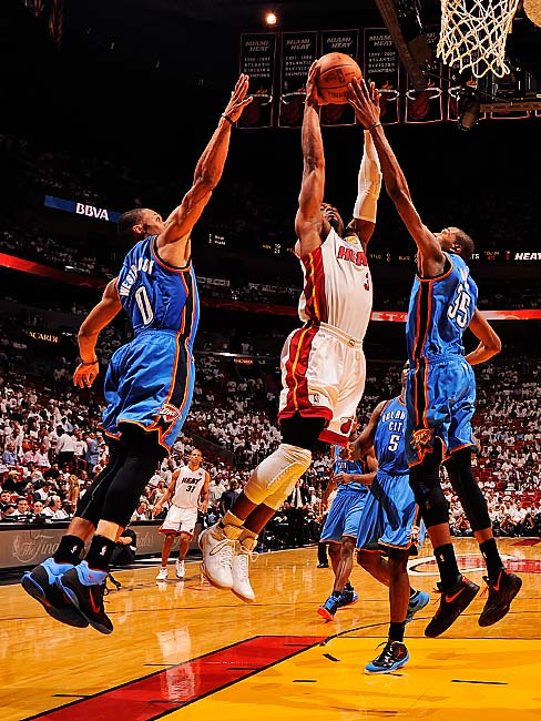 Dwyane Wade (pictured) also scored 25 points, made a big block on a Derek Fisher shot and stole a key rebound from Kevin Durant down the stretch to help Miami.