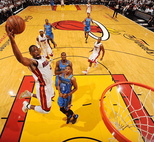 Dwyane Wade scores two of his 24 points.