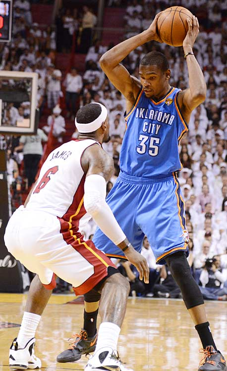 LeBron James played tough on both ends of the floor, doing his best here to keep Kevin Durant at bay.