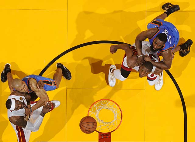 LeBron James (left) and Dwyane Wade boxed out Derek Fisher and James Harden, respectively.
