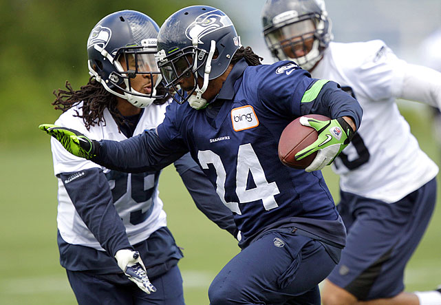 """Marshawn Lynch hopes to go """"beastmode"""" again this season with the Seahawks' electric new jerseys on display at the Virginia Mason Athletic Center camp."""