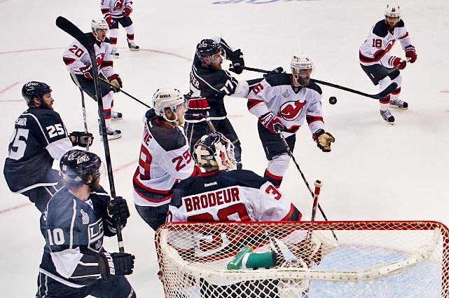 Devils defenseman Andy Green lends his goalie a helping hand.