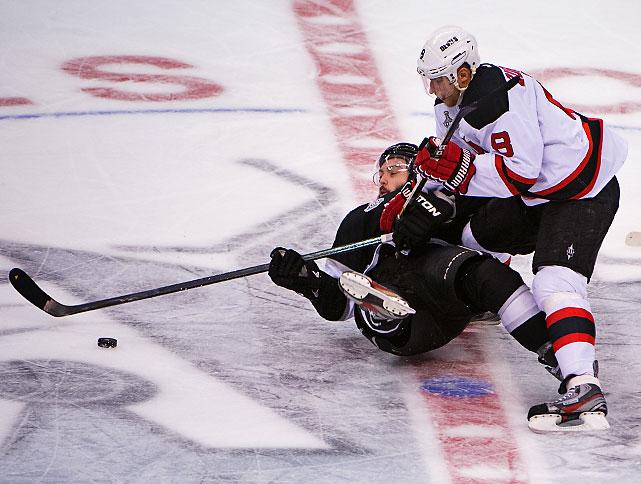Dainius Zubrus sends Drew Doughty to the ice.