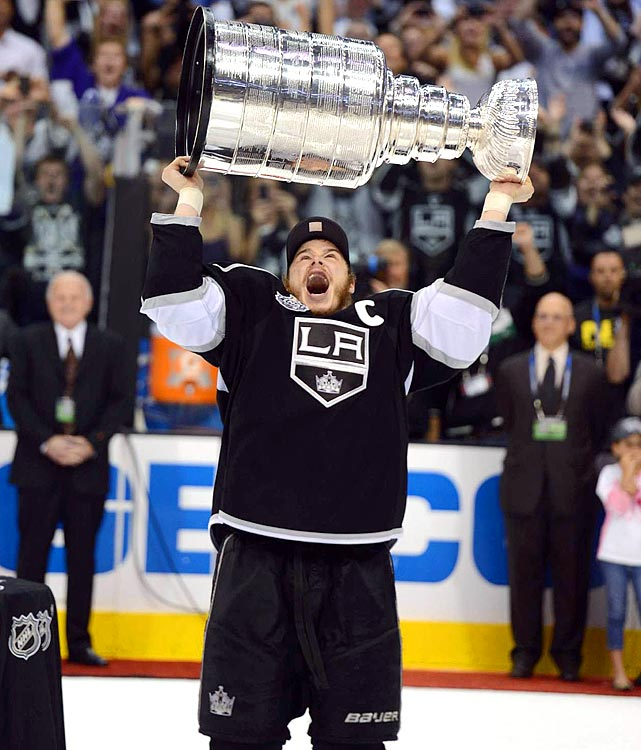 Dustin Brown practically snatched the Stanley Cup away from NHL Commissioner Gary Bettman, skating directly to center ice and thrusting it skyward.  Forgive his haste. The Kings' captain had only been waiting his whole life for this moment.  Brown accomplished what even Wayne Gretzky couldn't do in eight years in Los Angeles by lifting the Cup.