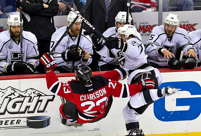 David Clarkson falls to the ice after a collision with L.A.'s Jarret Stoll.