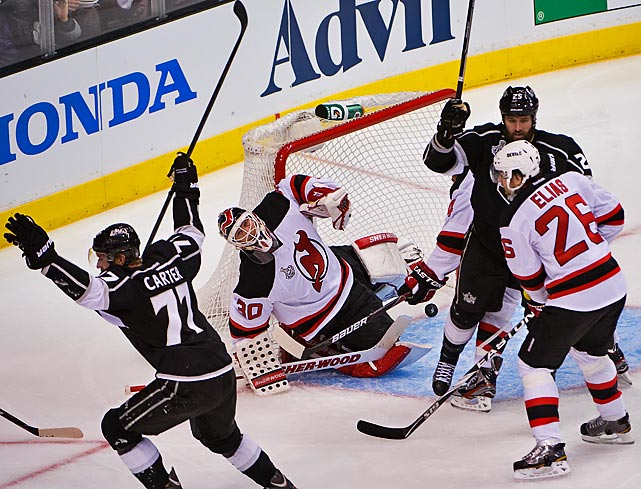 Martin Brodeur can't hide his disappointment as Jeff Carter celebrates his sixth goal of the playoffs.