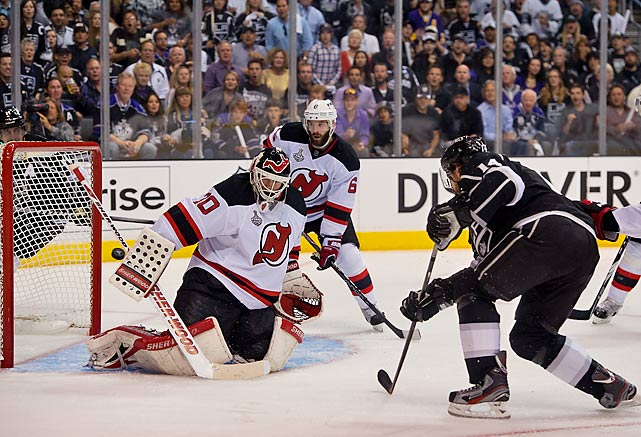 Justin Williams sends the puck past Martin Brodeur to score the Kings final goal of the night.