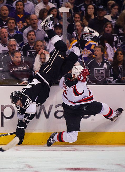 Kings center Trevor Lewis is toppled by a big hit from Devils defenseman Andy Greene during the third period.