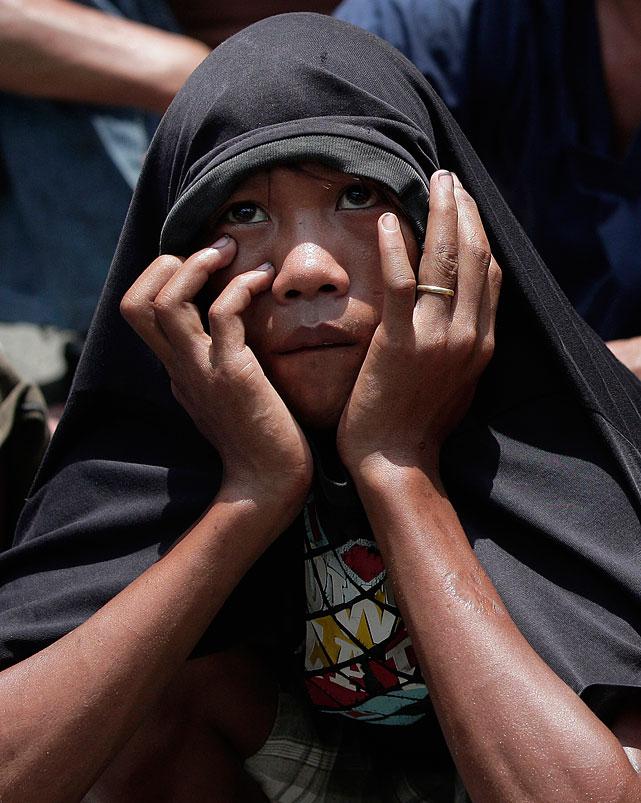 A Filipino fan watches the Pacquiao-Bradley fight in Marikina, east of Manila.