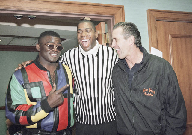 Riley jokes with Magic Johnson and former New York Giants linebacker Lawrence Taylor at an AIDS fundraiser in 1995.