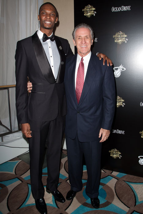 Riley poses with Chris Bosh at the Chris Bosh Home Strong Celebrity Gala at Fontainebleau Miami Beach.