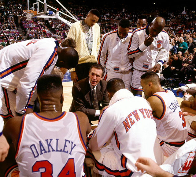 Riley talks to his team during a timeout in a 1991 regular season game. Riley took the Knicks to the Eastern Conference Semifinals in his first season in New York. Though they would lose in seven games to the eventual champion Chicago Bulls, the Knicks were the only team to take the champs to seven games.