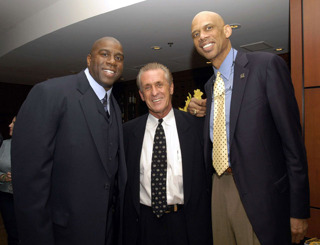 Riley poses for a photo with legends Magic Johnson and Kareem Abdul-Jabbar during a 1985 Los Angeles Lakers championship reunion.