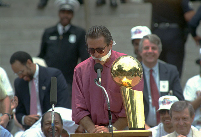 Riley famously gags himself at the 1988 Lakers' championship parade to avoid making any predictions about the next season. Perhaps he should have talked; the Lakers would be swept out of the finals by the Pistons the next season.