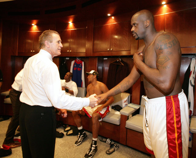"Riley shakes hands with Shaquille O'Neal after winning game six of the 2006 Eastern Conference Finals. The exchange was probably as awkward as it appears. The two have a well-documented feud that O'Neal detailed in his 2011 autobiography ""Shaq Uncut."""