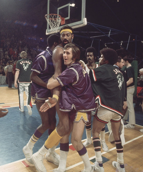Riley hugs teammate Wilt Chamberlain after a game against the Milwaukee Bucks in the Western Conference Semifinals. The Lakers would dispatch of the Bucks in six games and eventually win the NBA Finals in five games over the New York Knicks.